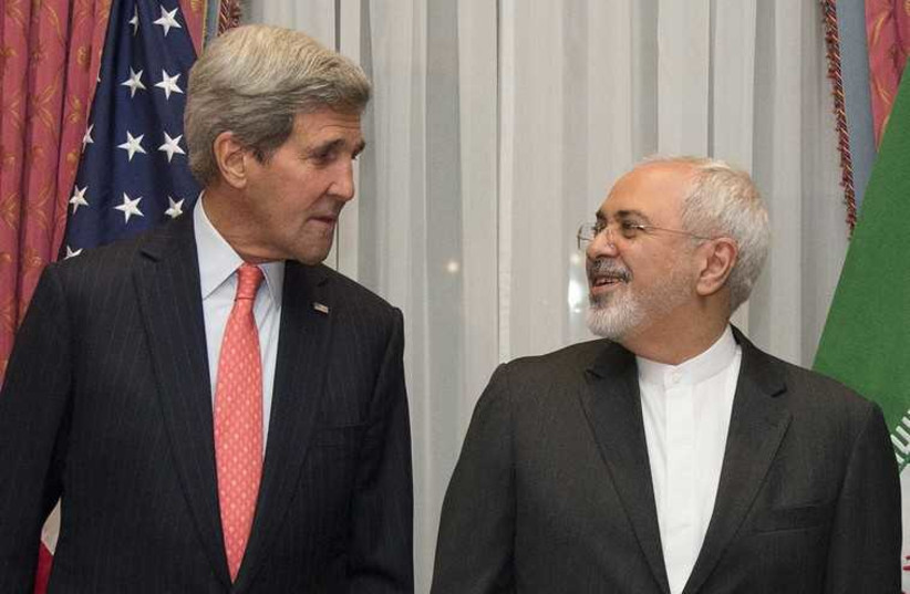 US. Secretary of State John Kerry (L) and Iran's Foreign Minister Mohammad Javad Zarif pose for a photograph before resuming talks over Iran's nuclear programme in Lausanne March 16, 2015. (photo credit: REUTERS)