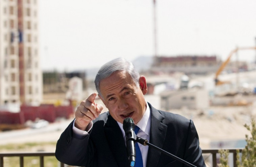 Netanyahu delivers a statement in Har Homa (photo credit: REUTERS)