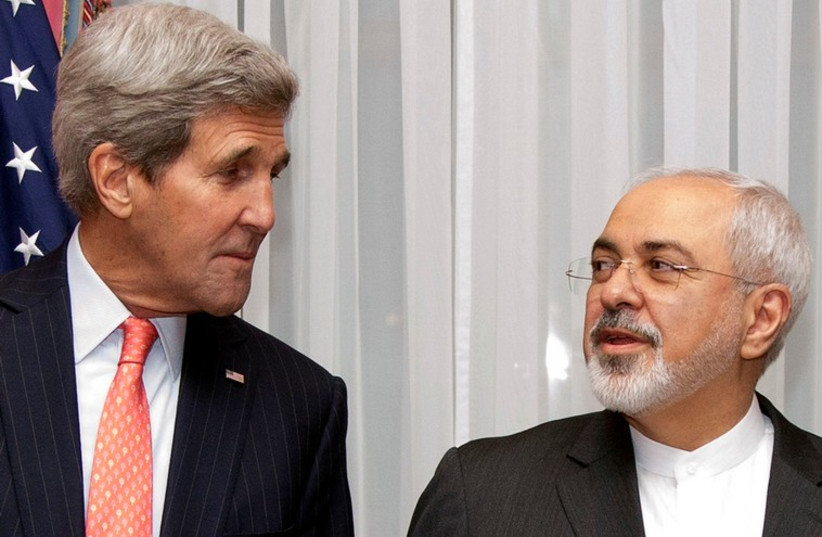 US Secretary of State John Kerry (L) and Iran's Foreign Minister Mohammad Javad Zarif pose for a photograph before resuming talks over Iran's nuclear program in Lausanne March 16, 2015. (photo credit: REUTERS)