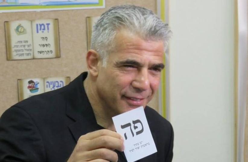 Yesh Atid leader Yair Lapid votes, March 17, 2015 (photo credit: PR)