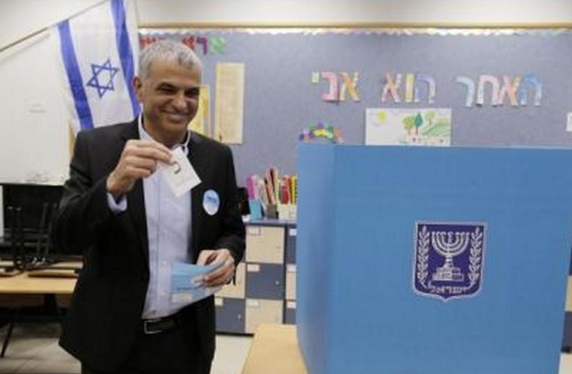 Kulanu leader Moshe Kahlon casts vote in  Haifa (photo credit: REUTERS)