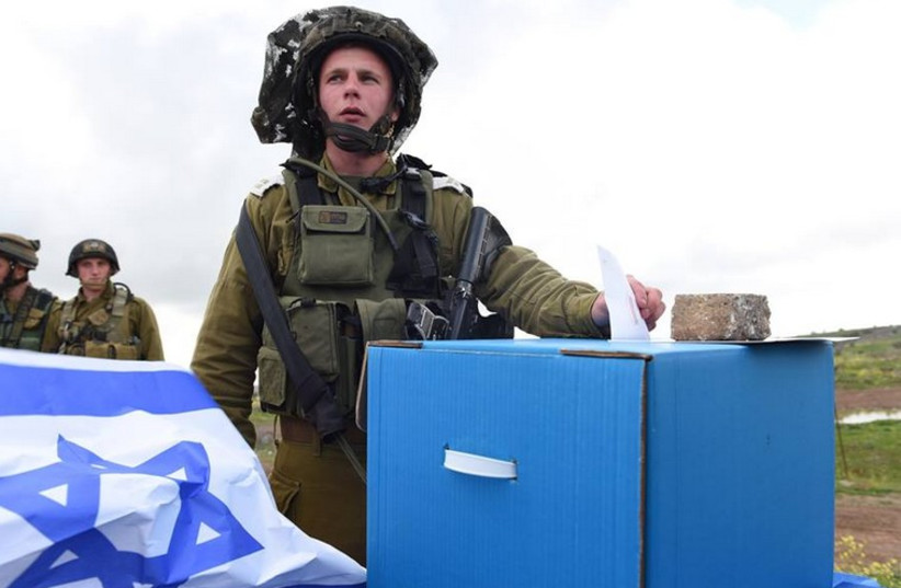 Israeli soldier casts his vote (photo credit: IDF)