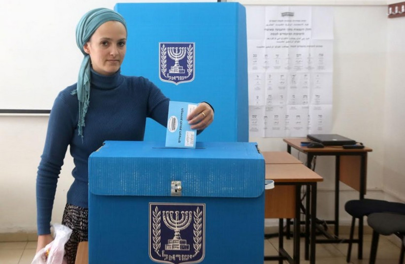 A woman casts her vote in the March 2015 elections (photo credit: MARC ISRAEL SELLEM)