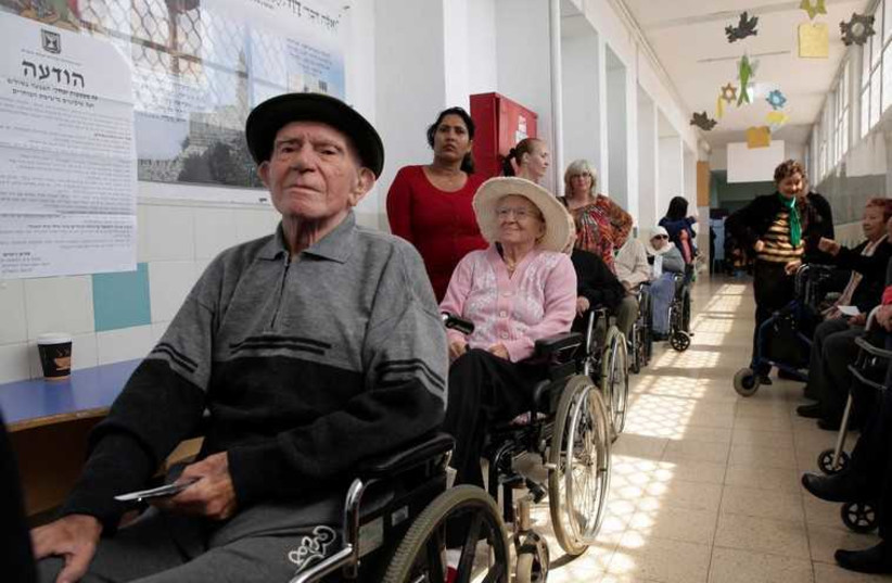 Elderly Israelis wait for their turn to vote  (photo credit: REUTERS)