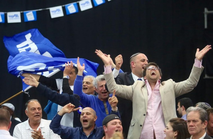 Likud supporters celebrate at party headquarters on Election Day (photo credit: MARC ISRAEL SELLEM/THE JERUSALEM POST)