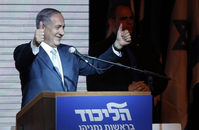 Prime Minister Benjamin Netanyahu gestures during his victory speech at Likud headquarters (photo credit: REUTERS)