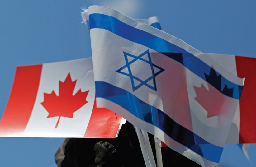 The flags of Israel and Canada (photo credit: REUTERS)