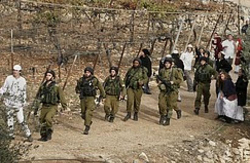 idf escort settelrs hebron 248 88 ap (photo credit: AP)