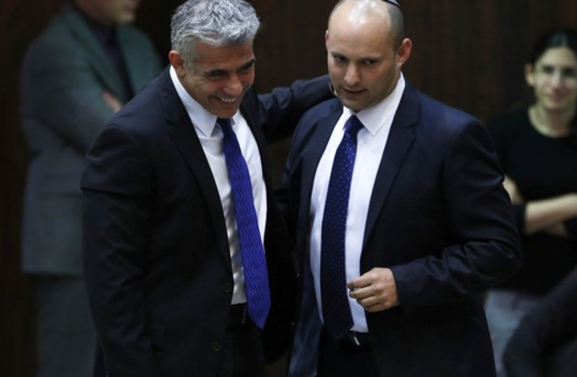 Yair Lapid and Naftali Bennett (photo credit: REUTERS)