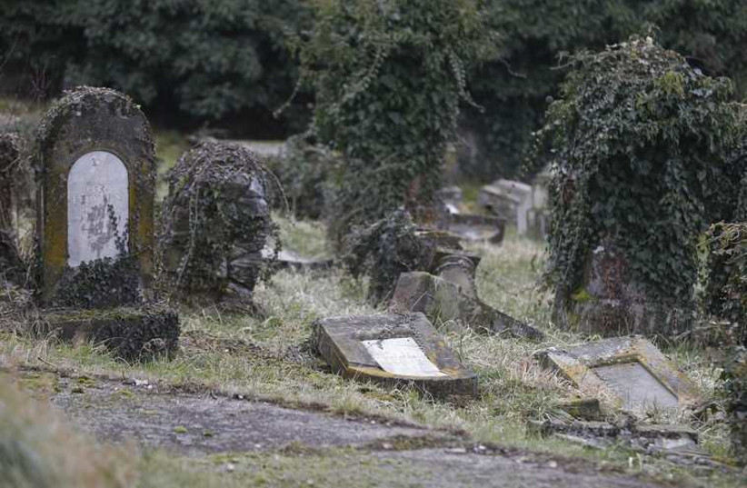 Desecrated tombstones of a Jewish cemetery  (Illustrative) (photo credit: REUTERS)