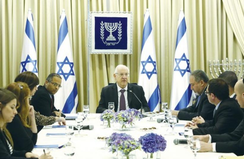 President Reuven Rivlin consulting with Yisrael Beytenu representatives (photo credit: DAVID VAAKNIN)