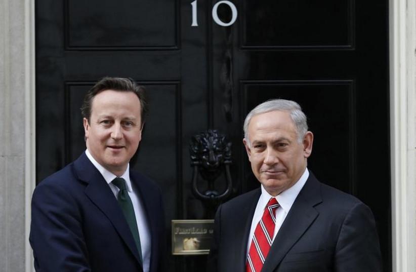 British Prime Minister David Cameron (L) greets Prime Minister Benjamin Netanyahu at 10 Downing Street in London (photo credit: REUTERS)