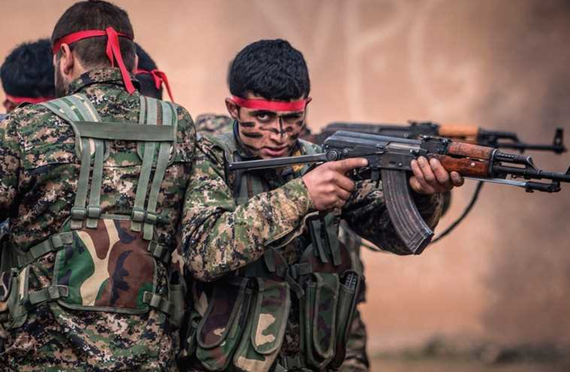 Fighters of the Kurdish People's Protection Units (YPG) in training at a military camp in Ras al-Ain, February 13 (photo credit: REUTERS)