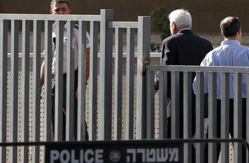 Former Israeli president Moshe Katsav walks towards the entrance to Maasiyahu prison in Ramle, near Tel Aviv, December 7, 2011 (photo credit: REUTERS)