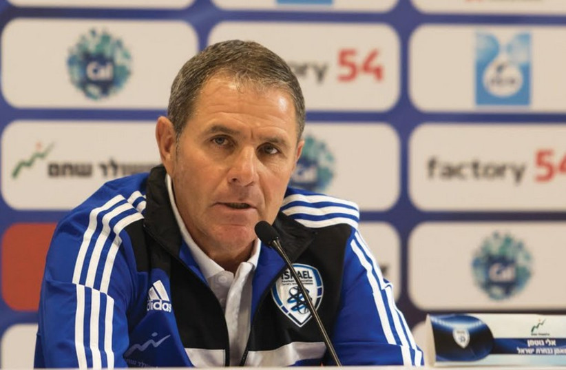 Israeli national soccer team coach Eli Gutman speaks to reporters (photo credit: ERAN LUF)