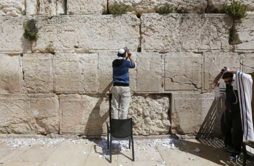 Western Wall cleaned for Passover. (photo credit: MARC ISRAEL SELLEM/THE JERUSALEM POST)