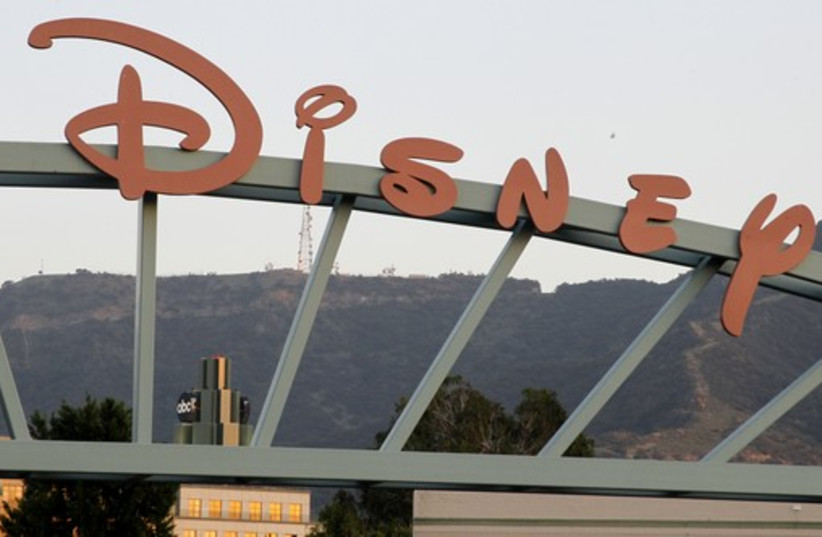 A part of the signage at the main gate of The Walt Disney Co. is pictured in Burbank, California (photo credit: REUTERS)