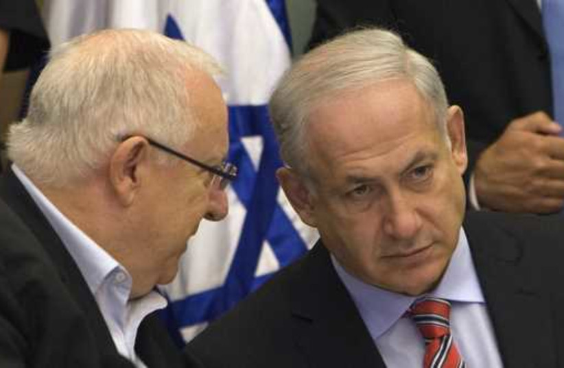 Prime Minister Benjamin Netanyahu listens to President Reuven Rivlin (photo credit: REUTERS)