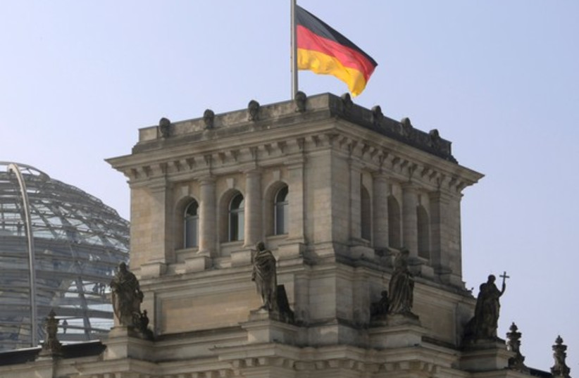 German flag flutters half-mast on top of the Reichstag building, the seat of the German lower house of parliament Bundestag in Berlin, March 25 (photo credit: REUTERS)