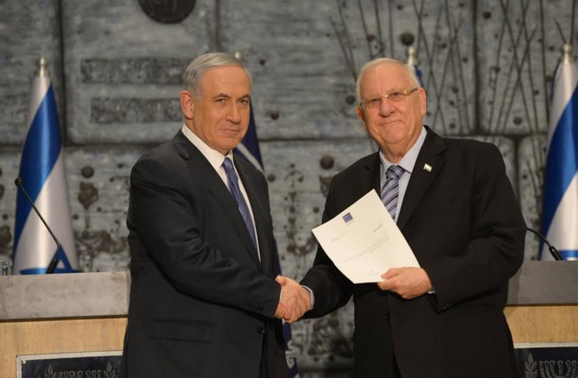 President Reuven Rivlin tasks Prime Minister Benjamin Netanyahu with forming Israel's 34th government, March 25 (photo credit: PRESIDENTIAL SPOKESPERSON OFFICE)