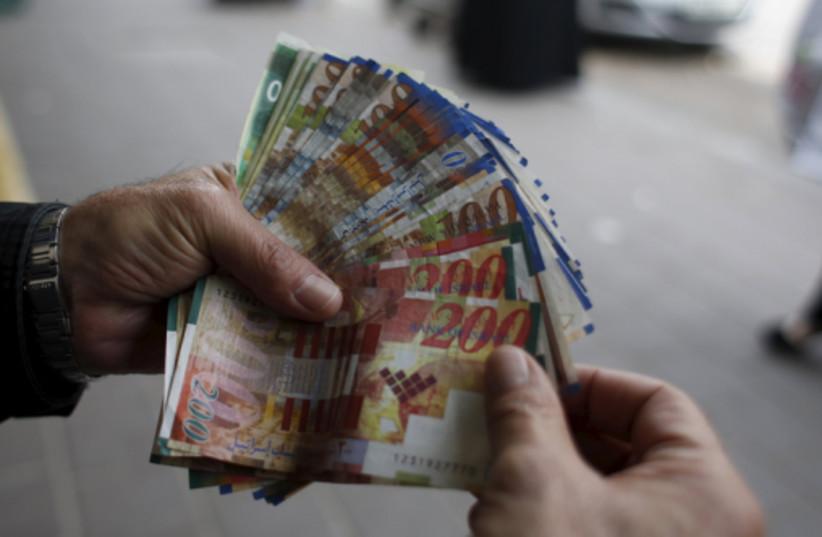 money (photo credit: REUTERS)