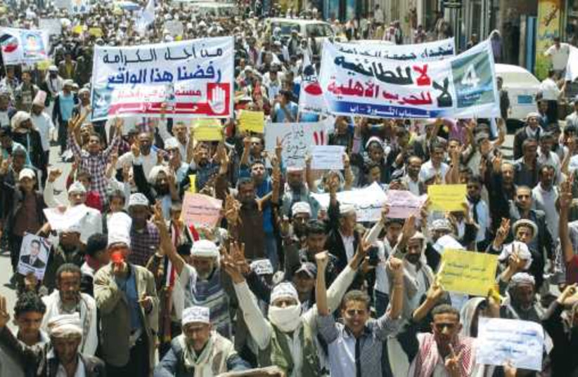 Anti-Houthi protesters demonstrate in Ibb, Yemen, on March 21. (photo credit: REUTERS)