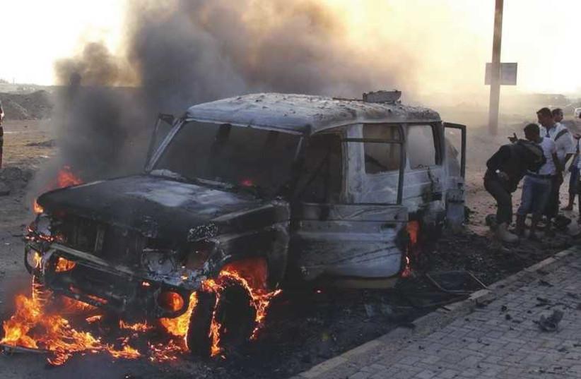 Sunni-Shi'ite wars going global (photo credit: NABEEL QUAITI/REUTERS)