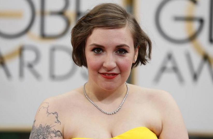 Actress Lena Dunham arrives at the 71st annual Golden Globe Awards in Beverly Hills, California  (photo credit: REUTERS)