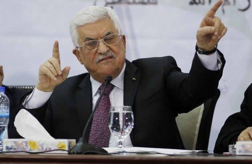 Palestinian Authority Chairman Mahmoud Abbas gestures as he speaks during a meeting for the Central Council of the Palestinian Liberation Organization in Ramallah (photo credit: REUTERS)