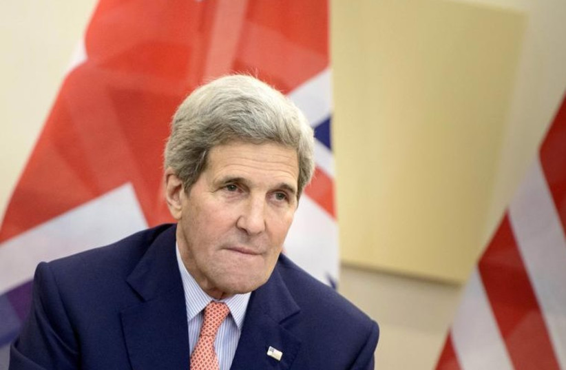 US Secretary of State John Kerry waits for the start of a trilateral meeting at the Beau Rivage Palace Hotel in Lausanne (photo credit: REUTERS)