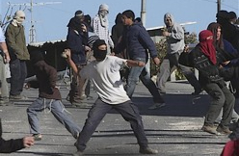 settlers throw stones 248 ap (photo credit: AP)