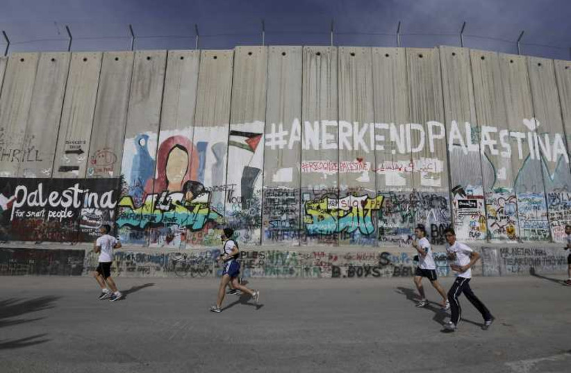 Participants run in Israeli Bible Marathon in the West Bank town of Bethlehem. (photo credit: REUTERS)