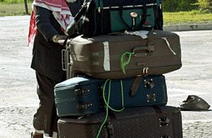 arab suitcases rafah 298 (photo credit: AP)