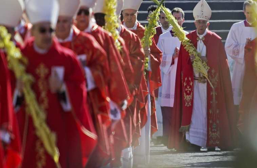 Pope Francis leads the Palm Sunday mass at Saint Peter's Square at the Vatican (photo credit: REUTERS)