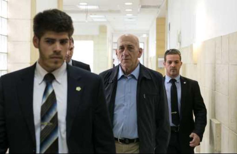 Former prime minister Ehud Olmert in the Talansky retrial, March 30, 201 (photo credit: MOR SHAULI)