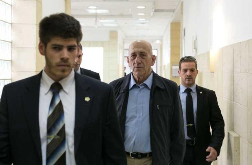 Former prime minister Ehud Olmert in the Talansky retrial, March 30, 2011. (photo credit: MOR SHAULI)