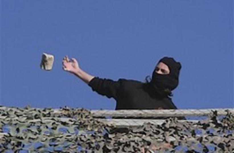 Jewish settler hurling rock 248.88 (photo credit: AP)