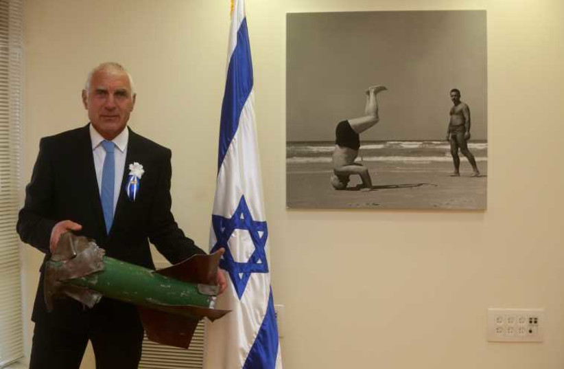 Yesh Atid's Haim Jellin brings Kassam rocket to Knesset as he's set to be sworn in (photo credit: MARC ISRAEL SELLEM/THE JERUSALEM POST)