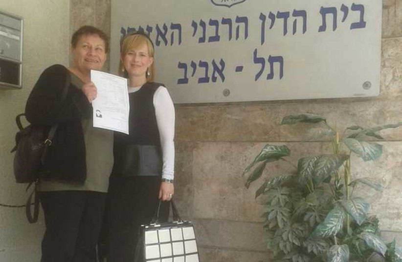 Raya Dinenberg (left) holds her Get, along side her Rabbincial Court Advocate Devorah Brisk outside the Tel Aviv Rabbinical Court (photo credit: YAD L'ISHA)