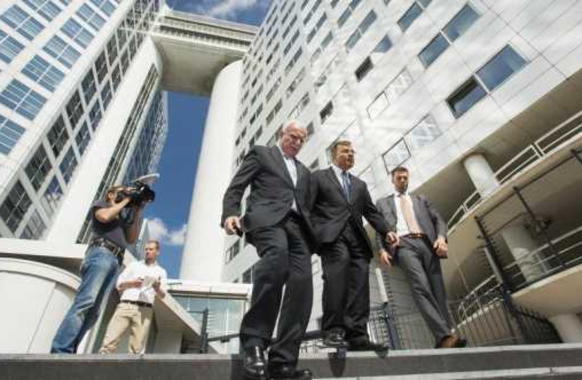 Palestinian Authority Foreign Minister Riad al-Malki (C) leaves the ICC at the Hague, August 5, 2014 (photo credit: REUTERS)