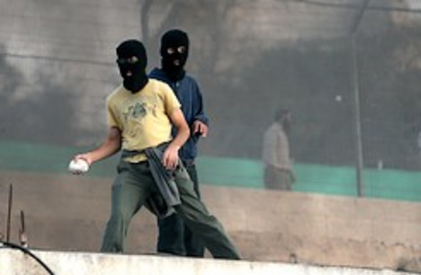 masked settlers riot hebron 248.88 aj (photo credit: Ariel Jerozolimski  [file])