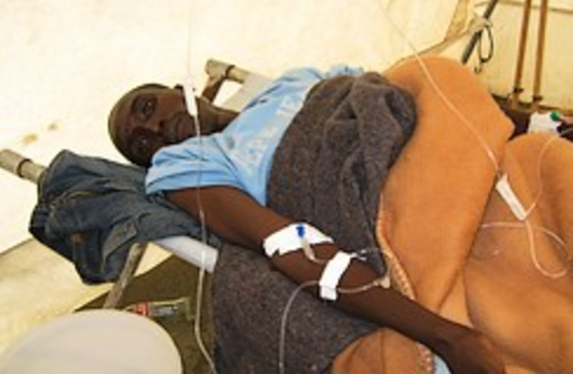 cholera zimbabwe patient 248.88 ap (photo credit: )