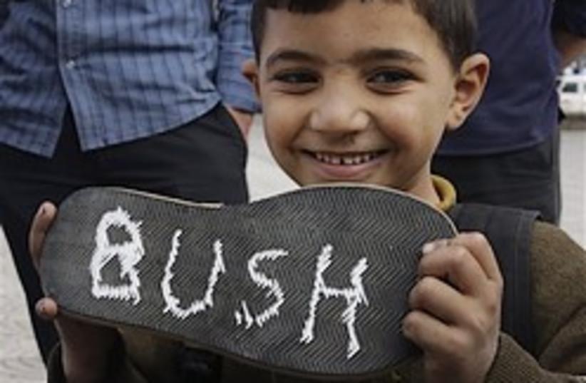 bush shoes 248.88 (photo credit: AP)