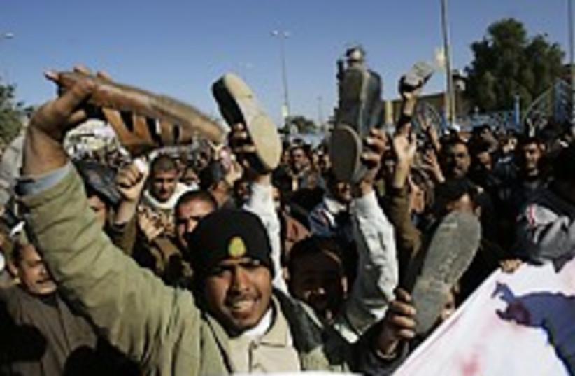 iraq shoe protest 248.88 (photo credit: AP)