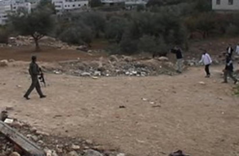 btselem soldier shoot hebron 248 88 (photo credit: B'Tselem)