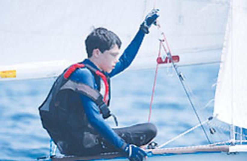 Boy on boat 88 248 (photo credit: Courtesy)
