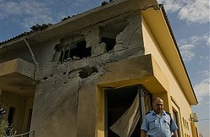 kassam damage cop nice 248 88 (photo credit: AP)