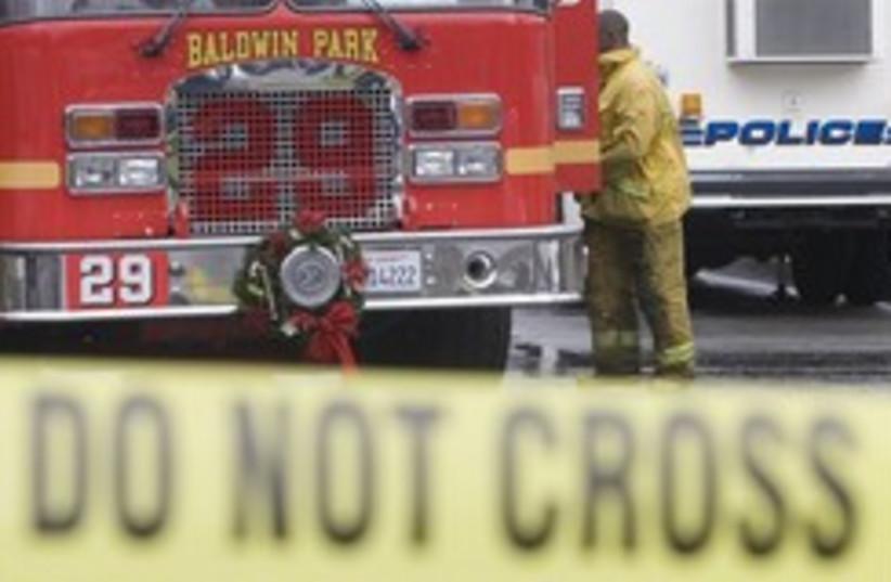 evil santa shooting scene ap 248.88 (photo credit: AP)