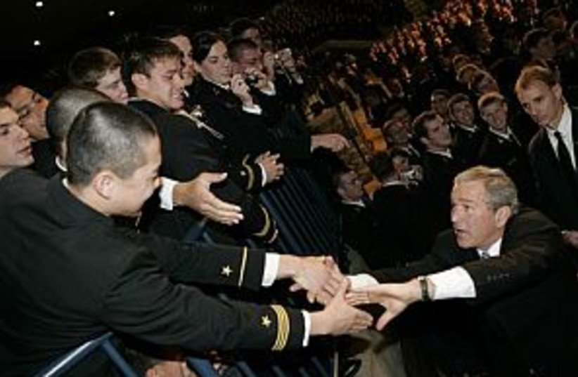 bush with troops 298 (photo credit: AP)