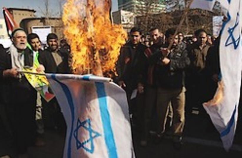 Iranians burn Israeli flags 248.88 (photo credit: AP)